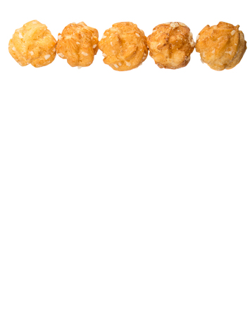 sprinkled: Choux pastry sprinkled with sugar over white background