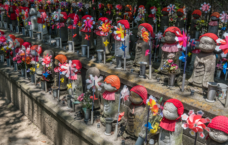 unborn: TOKYO, JAPAN - JUNE 2ND 2016.Little children statues represent unborn children, including miscarried, aborted, and stillborn in Zojoji Temple, Tokyo. Parents can decorate these statues with clothing and toys. Editorial
