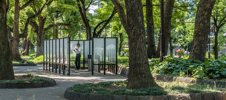 punishable: TOKYO, JAPAN - JUNE 2ND 2016. Designated smoking sections in a Tokyo public park. In Tokyo it is punishable by fine if caught smoking outside these areas.