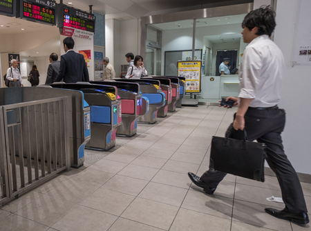 intercity: TOKYO, JAPAN - MAY 31ST, 2016. Crowds at Tokyo Railway Station. Tokyo Railway Station is the main intercity rail terminal in Tokyo and the busiest station in Japan in terms of number of trains per day