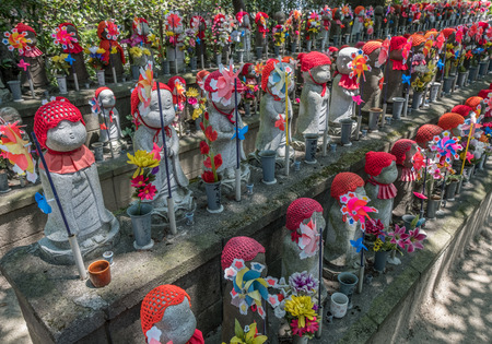 unborn: TOKYO, JAPAN - JUNE 2ND 2016Little children statues represent unborn children, including miscarried, aborted, and stillborn in Zojoji Temple, Tokyo. Parents can decorate these statues with clothing and toys Editorial