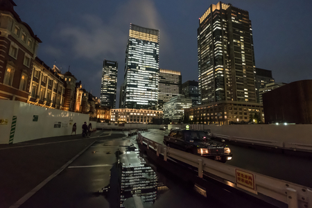 developement: TOKYO, JAPAN - MAY 30TH 2016. Tokyo buildings and skyline at night after rain. Editorial