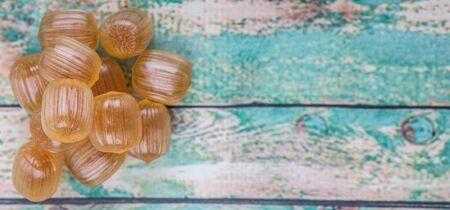 hard candy: Japanese caramel honey hard candy over wooden background Stock Photo