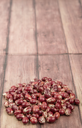 speckled: Pinto beans or speckled beans over wooden background Stock Photo