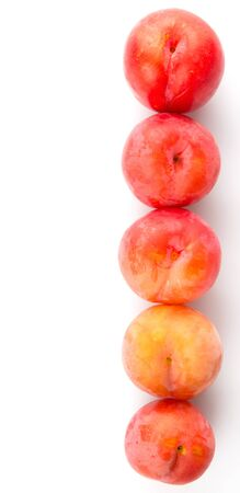 drupe: Japanese red plums over wooden background Stock Photo