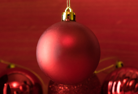 Christmas balls on over red wooden background Standard-Bild - 105405266