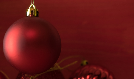 Christmas balls on over red wooden background Standard-Bild - 105405269