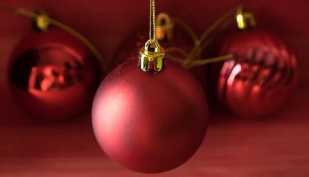 Christmas balls on over red wooden background Standard-Bild - 105383296