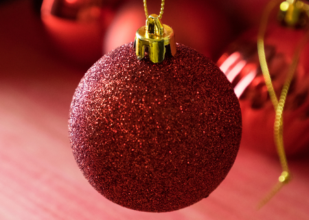 Christmas balls on over red wooden background Standard-Bild - 105394397