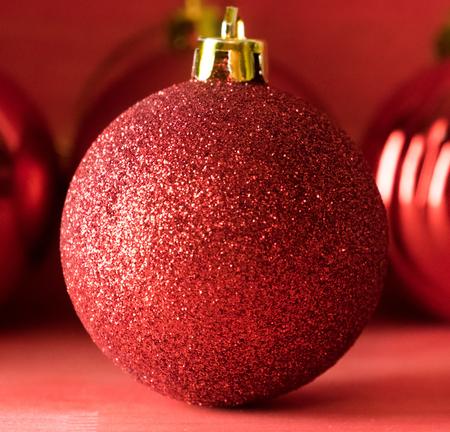 Christmas balls on over red wooden background Standard-Bild - 105405549