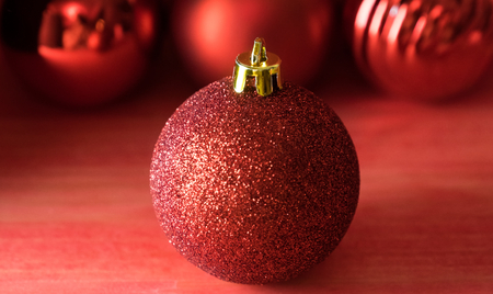 Christmas balls on over red wooden background Standard-Bild - 105405551