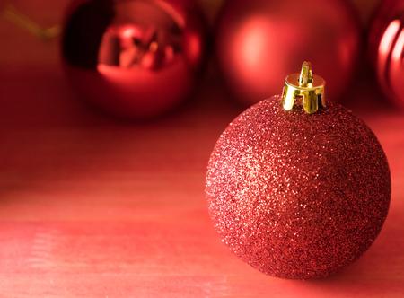 Christmas balls on over red wooden background Standard-Bild - 105405552