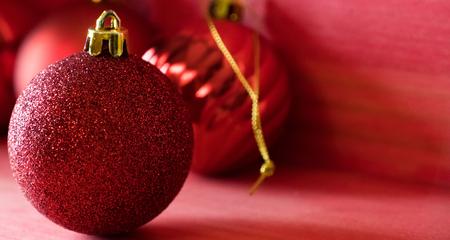 Christmas balls on over red wooden background Standard-Bild - 105412569