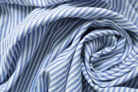 Striped fabric. Cotton, bedding, blue and white stripes on the fabric. Texture. Background.