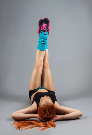 young red-haired girl doing exercises photo