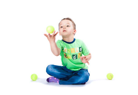 boy catches the ball on a white background photo