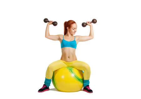 Health and Fitness woman in gym outfit with a Pilates ball doing exercises photo