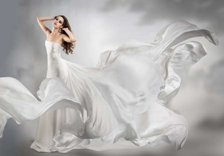 wind dress: beautiful young girl in flying white dress. Flowing fabric
