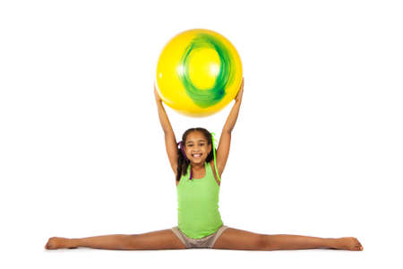 splits: girl is engaged in gymnastics. child sitting on the splits. isolated on a white background