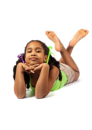 lying on floor: Cute little girl lie on the floor Stock Photo