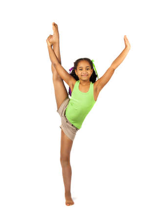 little girl dancing: girl gymnast on the training. Isolation on a white background Stock Photo