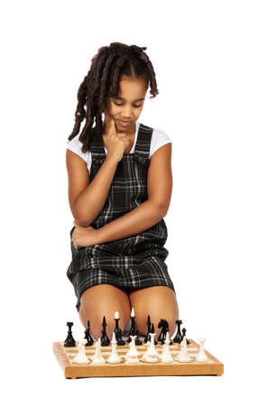 clever girl playing chess thinking photo