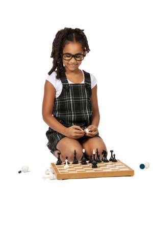 dark skin  girl playing  chess over white background photo