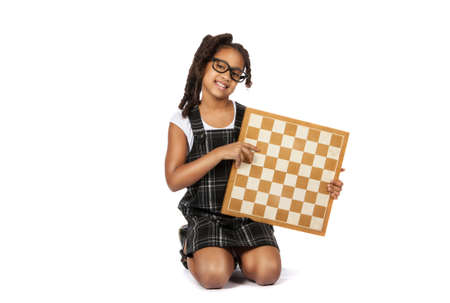 smart girl in glasses with a chessboard over white background photo