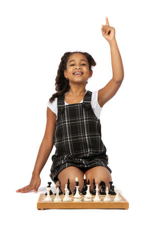 smart girl playing chess raised thumbs up. have an idea photo