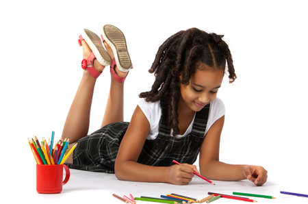 child drawing: cheerful girl draws pencil lying on the floor Stock Photo