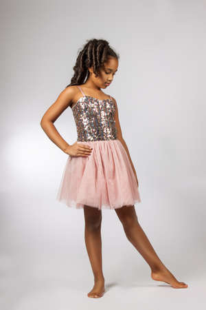 Cute little girl dance. Studio shot photo