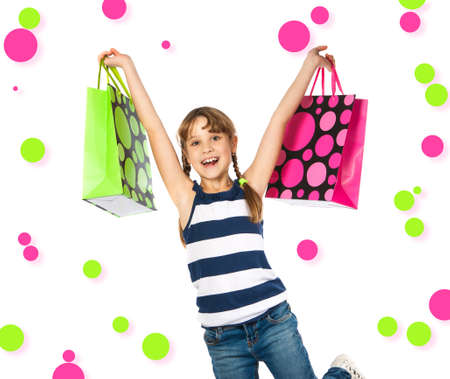 happy teenage girl with shopping bags Isolation on the white photo