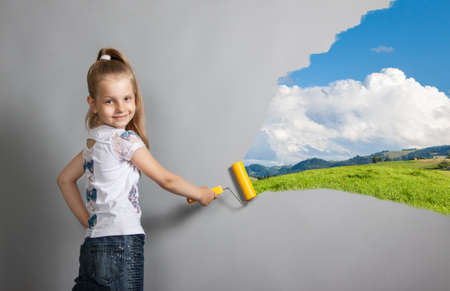 paint roller girl on a gray background photo