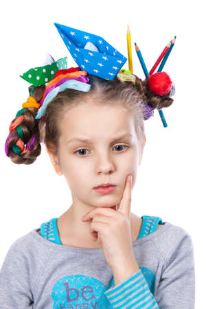 child and creativity, development. little girl doing creative thinking