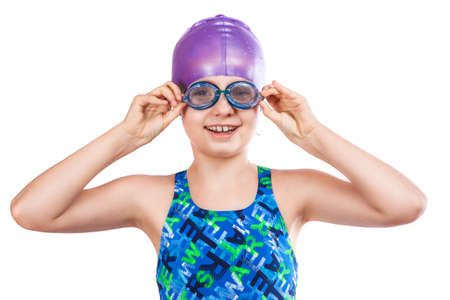 Portrait of a young girl in goggles and swimming cap. happy girl photo