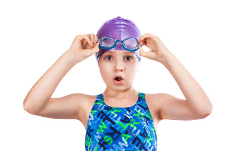 Portrait of a young girl in goggles and swimming cap. surprised girl photo