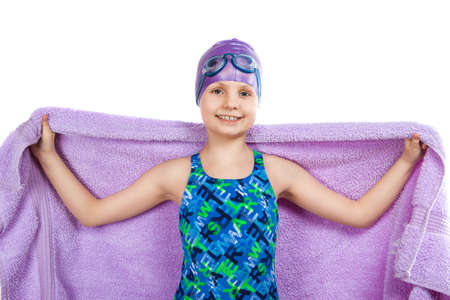 Portrait of a young girl in goggles and swimming cap. photo