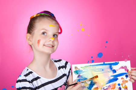 kids weaving: child and creativity, development. Portrait of a cheerful girl creative