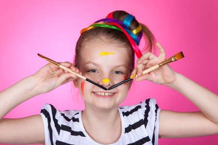 child and creativity, development. Portrait of a cheerful girl creative