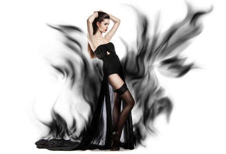 billowing: Girl in black dress billowing out flying transparent fabric. Model on a white background holding a flying dress