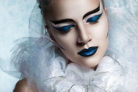 flawless: Winter portrait of a woman with creative makeup. snowy beauty. Flawless makeup, perfect shape. Cold beauty