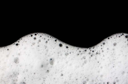 Foam bubbles abstract black background. Detergent 写真素材
