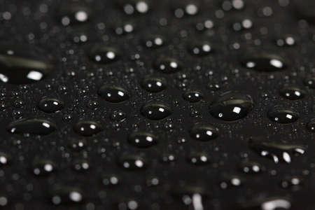 condensacion: drops of water on a dark background. beautiful abstract texture. macro Foto de archivo