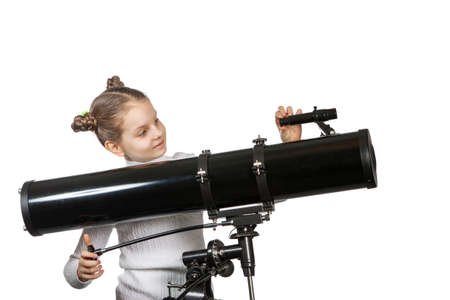 Child Looking Into Telescope Star Gazing Little girl isolated on a white background Stock Photo