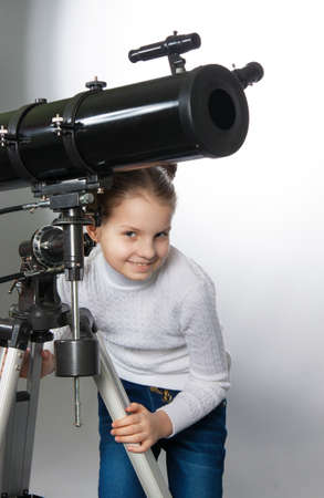 gazing: Child Looking Into Telescope Star Gazing Little girl isolated on a white background Stock Photo