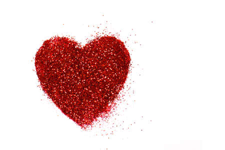 glitter makeup: red heart on a white background. Heart of glitter grains. glitter makeup. background, abstract Stock Photo