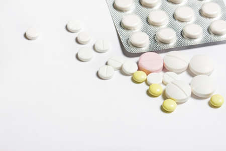 birth control pill: tablets on a white background top view. Close-up. Packaging of tablets and pills rasypanye. Medical background Stock Photo