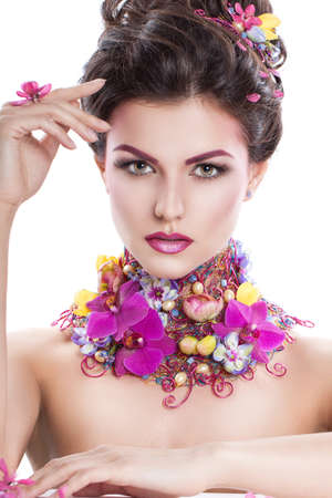 coronet: Fashion Beauty woman with flowers in her hair and around her neck. Perfect Creative Make up and Hair Style. Hairstyle. Bouquet of Beautiful Flowers. It can be used for advertising perfume