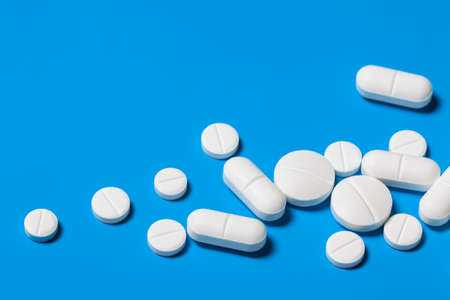 additional chemicals: Tablets close up on blue background. A variety of drugs closeup. Bright Medical background