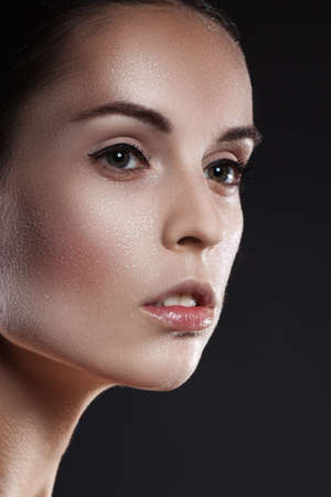 Beauty, fashion, make-up. Woman with glitter on her face. Beauty close-up portrait